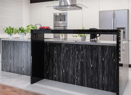 extractor hood: Photo of new kitchen with decorative black and white worktop Stock Photo