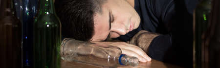 the unconscious: Unconscious drunken man sleeping on the table