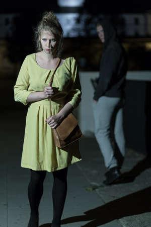 thievery: Young woman is very terrified on the street