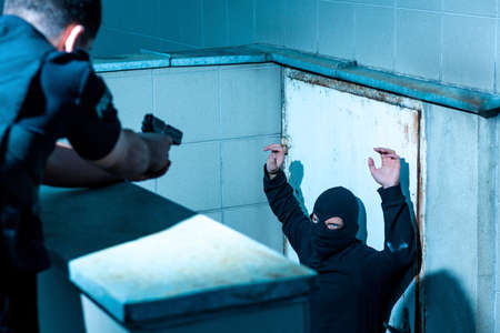 dangerous: Dangerous man is surrendering to the policeman