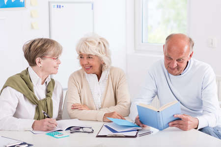 third age: Image of aged members of learning group sitting in class Stock Photo