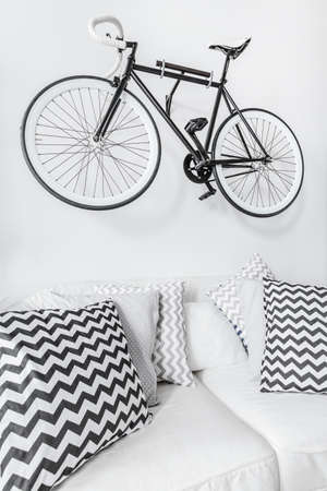 Bike suspended on the wall in modern interior