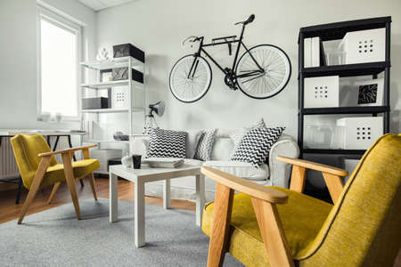 living: Modern space - yellow armchairs in black and white living room
