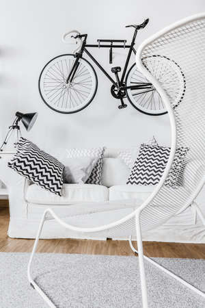 contemporary living room: Bicycle in black and white contemporary interior