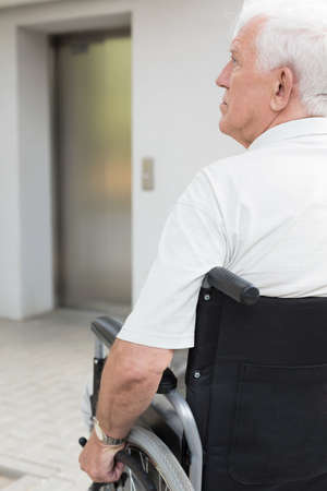 adapted: Independent senior man sitting on the wheelchair