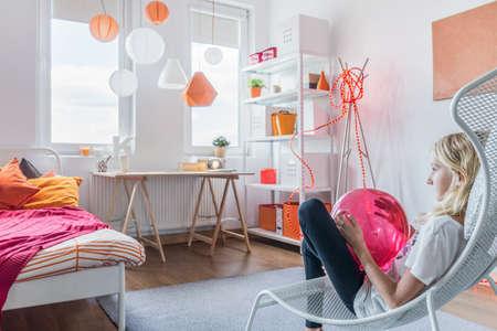 teen bedroom: Beauty teenage girl relaxing in her bedroom Stock Photo