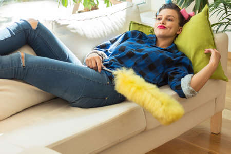 Perfect trendy housewife is relaxing on couch Stock Photo