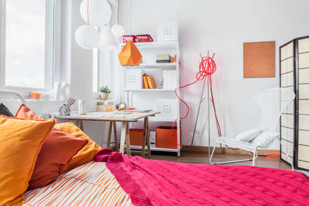 Red and orange bedroom for teen girl