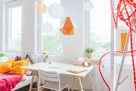 teen girl bedroom: Horizontal view of bright cozy girls room