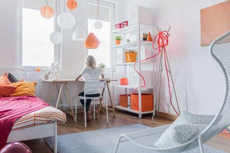 room decor: Girl sitting at the desk and doing homework