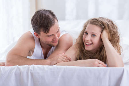 nude wife: Portrait of amorous couple in the bedroom