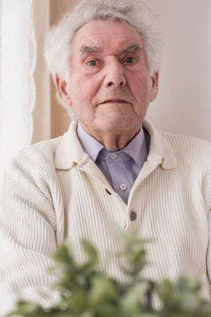 senescence: Portrait of content elderly man having professional care Stock Photo