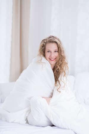 duvet: Girl in bed covered by white duvet