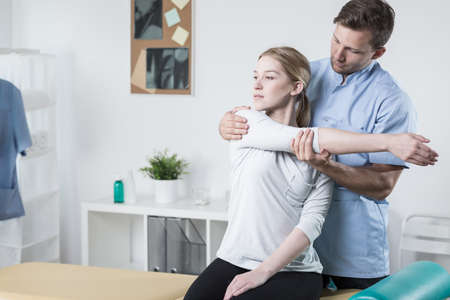 Picture of young woman during rehabilitation in professional clinic