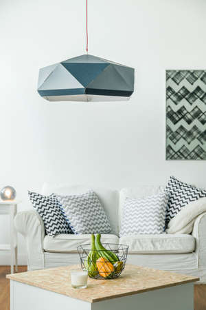 Picture of modern black swag lamp in room Stock Photo