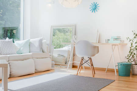 living room minimalist: Bright small cozy room with sophisticated decorations Stock Photo