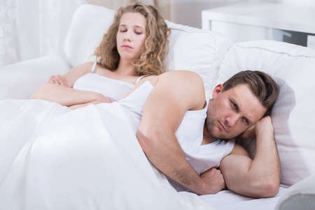 Image of young couple arguing in bed Stock Photo