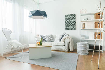 Trendy furniture in small cozy living room 스톡 콘텐츠