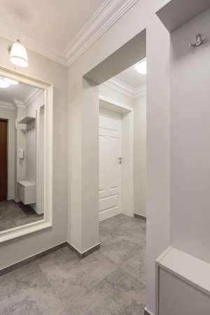 Vertical picture presenting part of modernistic and stylish hallway Stock Photo