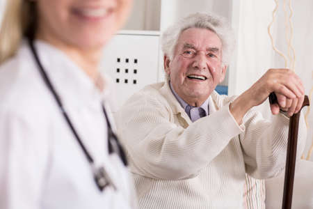 home  life: Image of smiling rich old man and his private medic