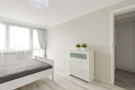 voguish: Horizontal image of bedroom in minimalist colors arranged by designer