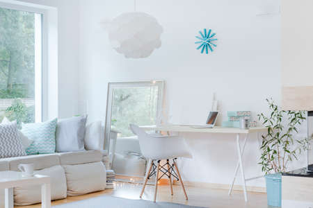 living room minimalist: Picture of sunny sophisticated studio room design Stock Photo