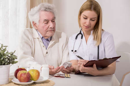 dignity: Photo of retired man on private medical consultation Stock Photo