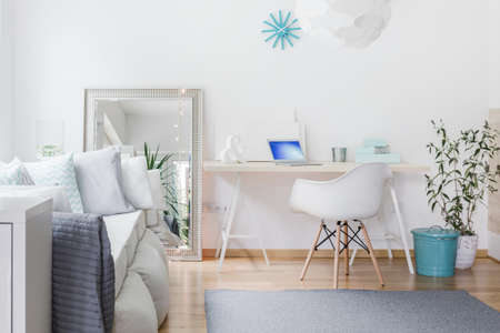 nook: Bright nook with desk in living room Stock Photo