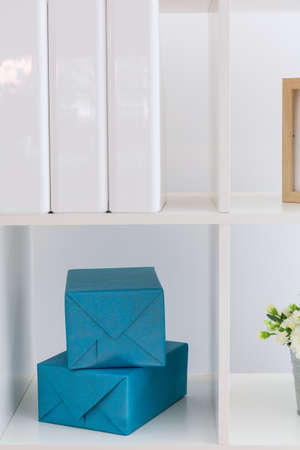 homelike: Piece of white simple rack with decorations