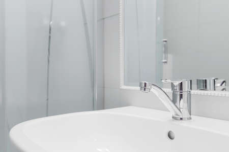 Close up of high quality white washbasin with simple tap Stock Photo