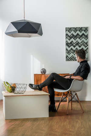 after work: Resting after work in modern living room