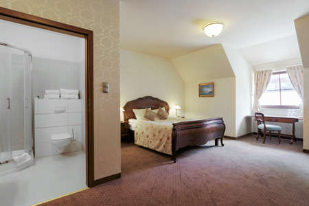 double room: Interior of luxurious double room with modern bathroom Stock Photo
