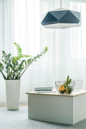 artistic design: Simple coffee table arrangement in white room Stock Photo