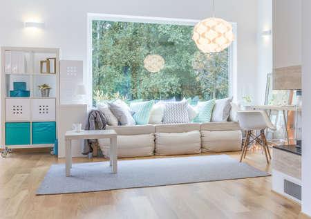Spacious bright living room with big window Archivio Fotografico