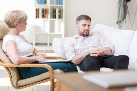 settee: Adult man telling about his problems during psychotherapy session