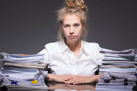 ambitious: Picture of tired ambitious female trainee abused by employer Stock Photo