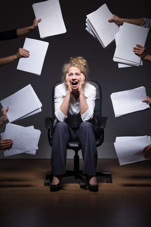 duties: Photo of ambitious trainee overwhelmed by job duties Stock Photo