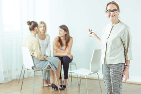 mature women: Coach giving seminar for modern active woman Stock Photo