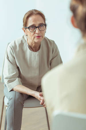 Psychotherapist talking with patient during therapy session