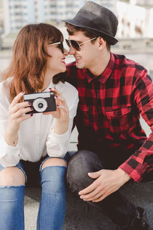 love life: Image of young couple with retro camera Stock Photo