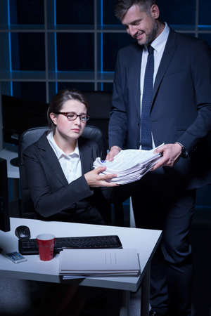 repression: Young secretary working extra hours in the office