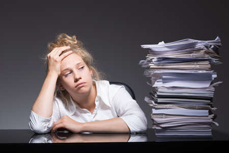 Photo of burnout office worker lying on desk