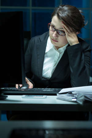 oppression: Young overworked businesswoman having problem at work