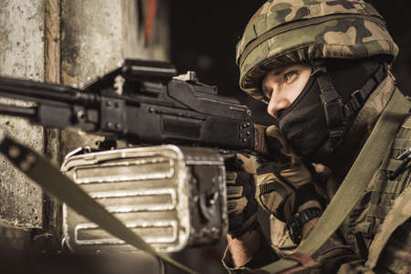 sniper training: Sniper in military uniform aiming at the target