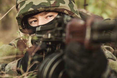 sniper training: Close-up of female soldier in the battlefield