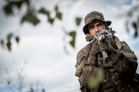 soldier with rifle: Picture of army soldier with a weapon Stock Photo
