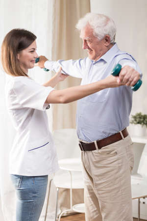 old house: Physiotherapist is helping elder and ill man