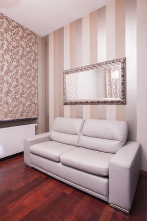 leathern: Leathern couch under the mirror in the house