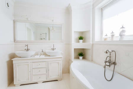 Photo of spacious bathroom with big bathtub