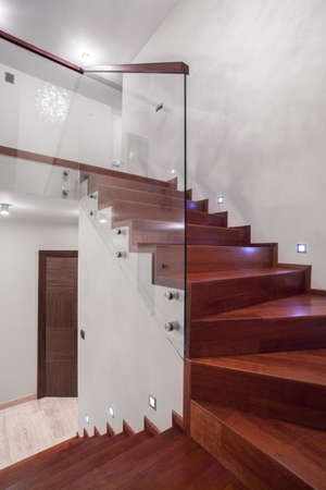 stairs: Modern and wooden stairs in the house Stock Photo